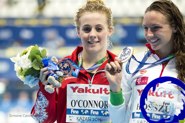 Siobhan Marie O'Connor celebrates her 200IM bronze with gold medallist Katinka Hosszu who she will meet again in Rio - pic: Simone Castrovillari